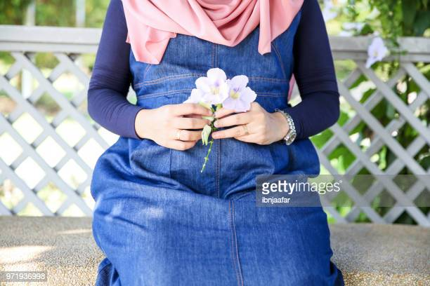 young couple pregnant women with husband sit together - beautiful wife pics stock pictures, royalty-free photos & images