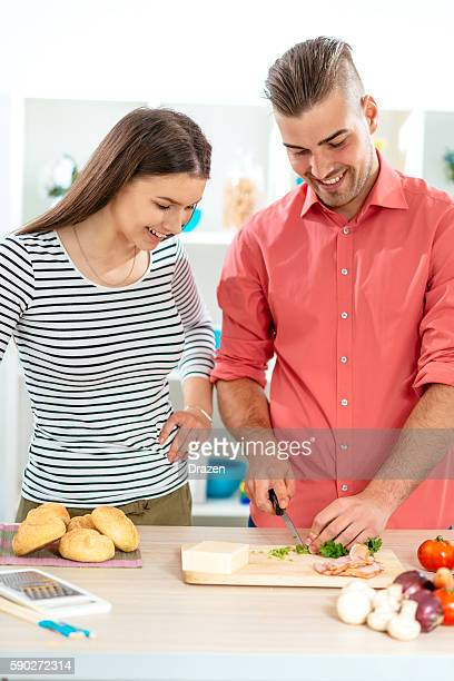 Young couple preparing dinner at home