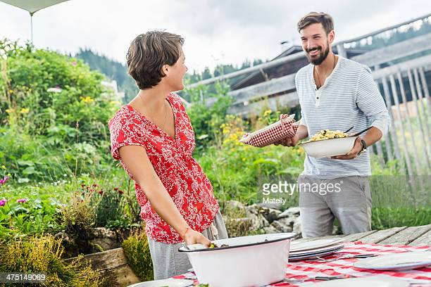 Young couple preparing picnic lunch, Tyrol, Austria