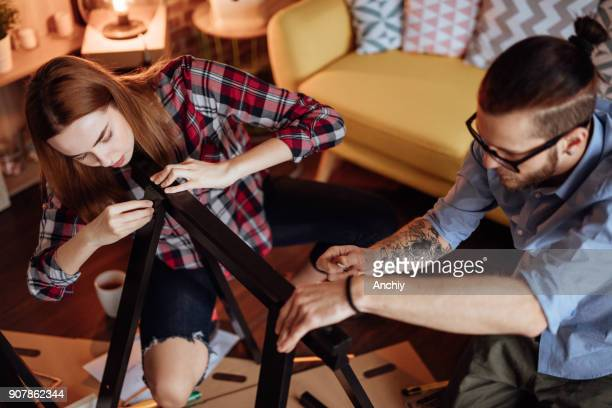 Young couple putting together new furinture