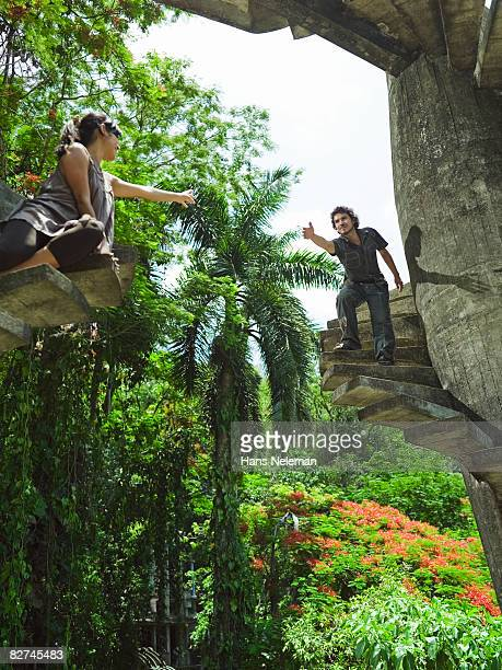 young couple reaching for each other  - las posas stock pictures, royalty-free photos & images