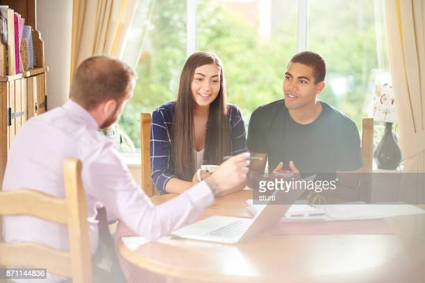 young couple receiving some financial advice