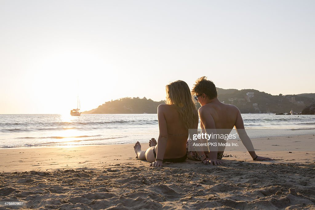 Young Couple Relax On Beach Listen To Music Stock Photo  Getty Images-7841