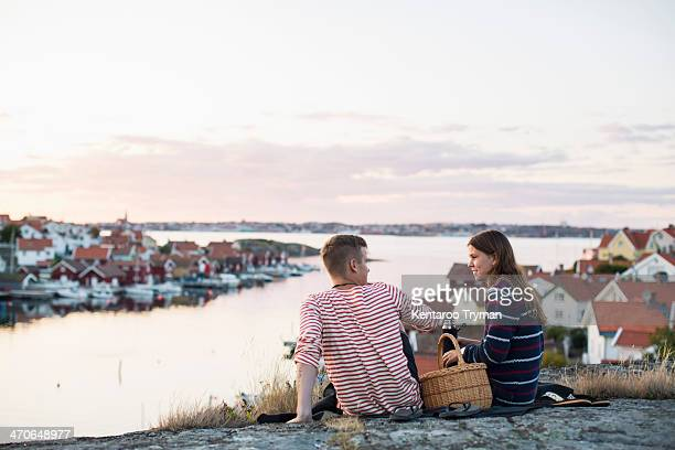 Young couple relaxation by lake