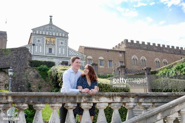 young couple relaxing by san miniato al monte church, florence, toscana, italy - san miniato stock pictures, royalty-free photos & images