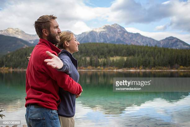 Young couple relaxing by the lake