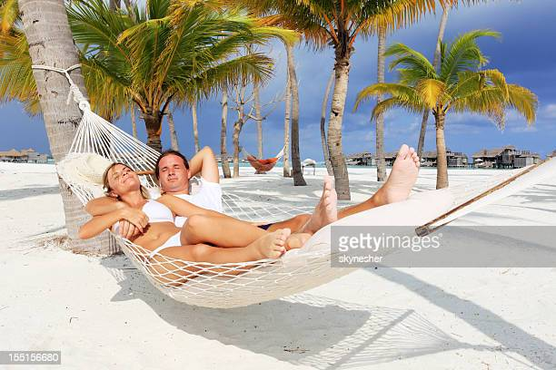 Young couple relaxing in a hammock.