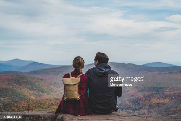A Young Couple Relaxing in nature in Autumn