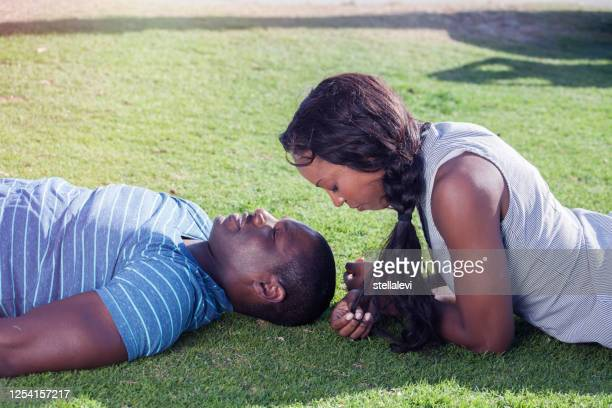 young couple relaxing in nature - stellalevi stock pictures, royalty-free photos & images