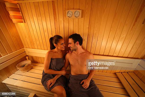 Young couple relaxing in the sauna