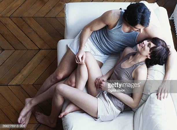 Young couple relaxing on sofa, elevated view
