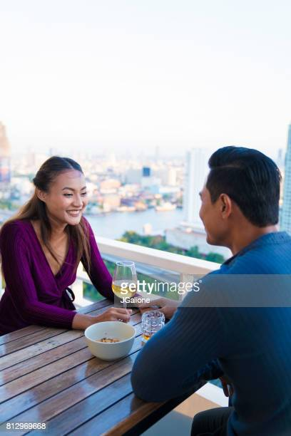 Young couple relaxing on the balcony together