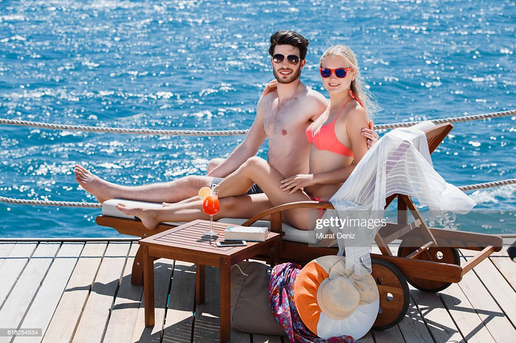Young couple relaxing on the beach : Stock Photo