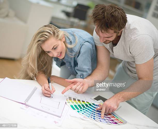 Young couple remodelling their house