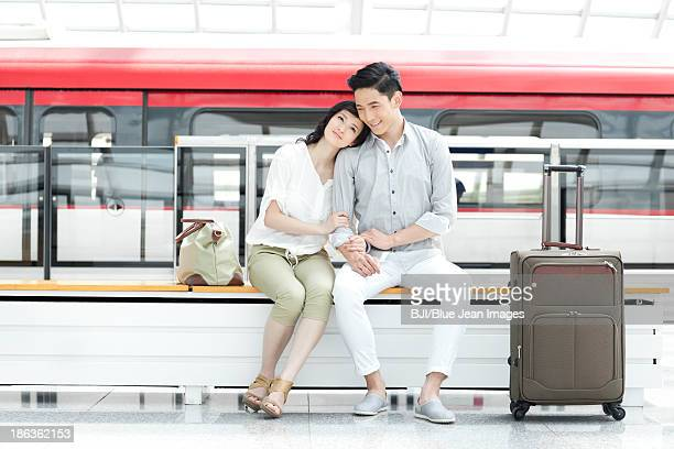 Young couple resting at subway station