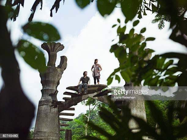 young couple resting on an surreal structure - las posas stock pictures, royalty-free photos & images