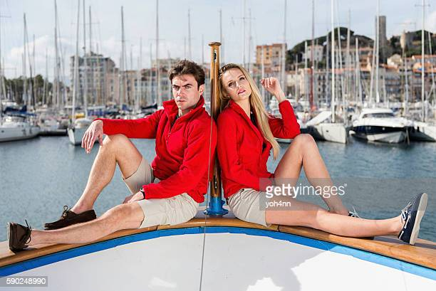 Young couple resting on luxury yacht