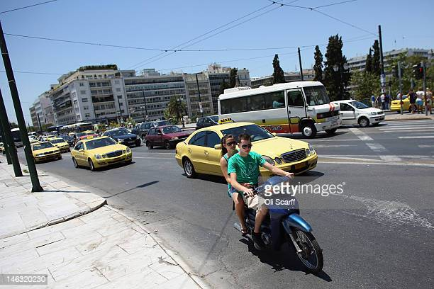 Young couple ride a scooter past Syntagma Square on June 14, 2012 in Athens, Greece. The Greek electorate are due to go to the polls in a re-run of...
