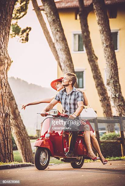 Young Couple Riding a Vintage Scooter