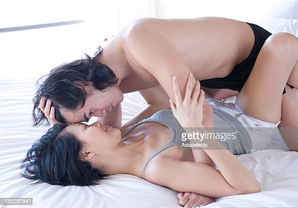 Young couple romancing on the bed