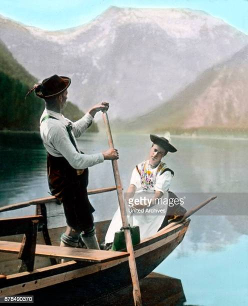 A young couple rowing on lake Koenigssee