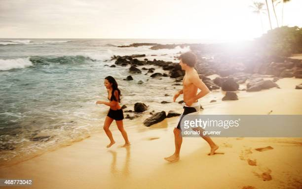 Young Couple Running and Laughing on Tropical Beach
