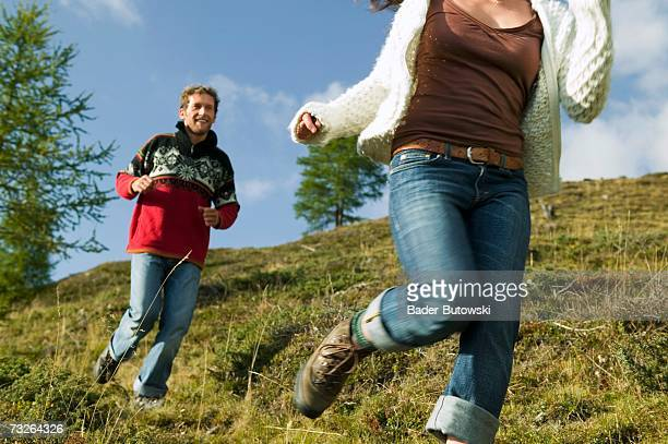 Young couple running in mountains