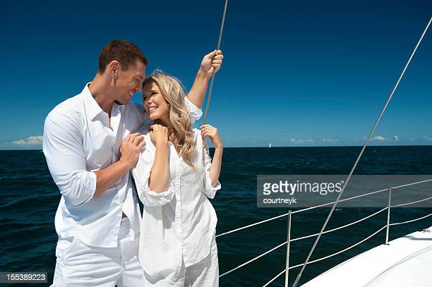 young couple sailing over blue sea