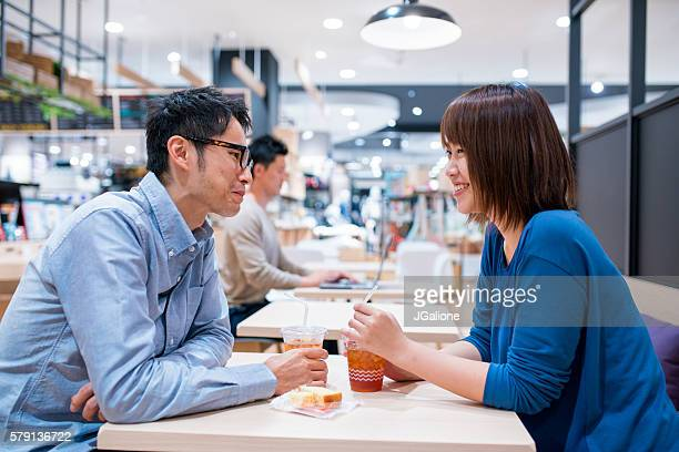 Young couple sat in a cafe together