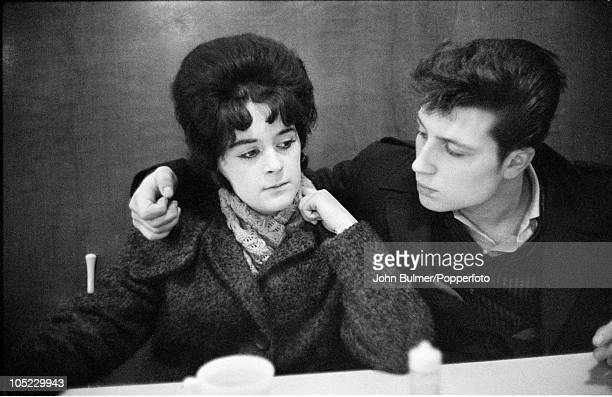 Young couple seated at a table in a cafe in the Black Country, West Midlands, January 1961.