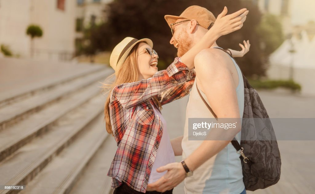 Young couple seeing each other after a long time. : Stock Photo