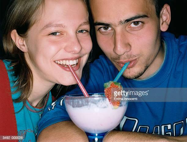 Young Couple Share Milkshake