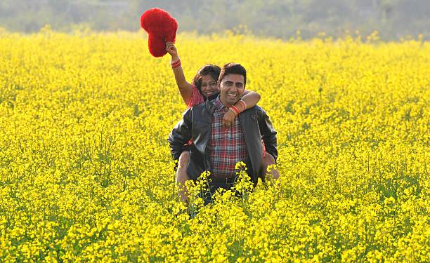 A young couple sharing a light moment in an open field on the outskirts of Chandigarh as they celebrated Valentine's Day on February 14 2015 in...