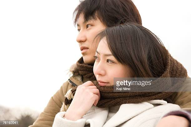 Young couple sharing scarf