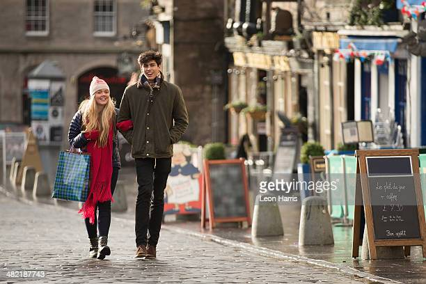 a young couple shop in the grassmarket in edinburgh, scotland - edinburgh scotland stock pictures, royalty-free photos & images