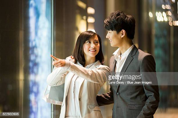 Young couple shopping after work