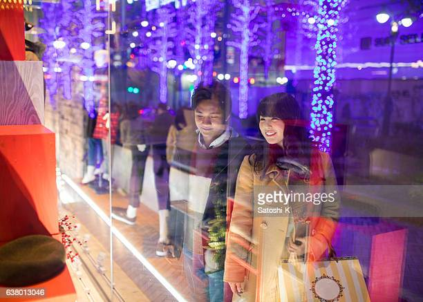 Young couple shopping at Christmas night