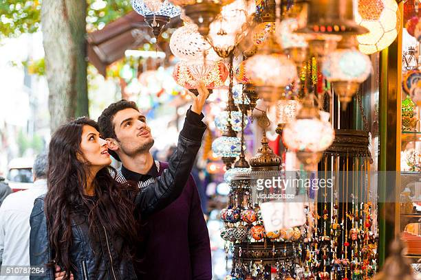 Young Couple Shopping for Goods in Street Bazaar