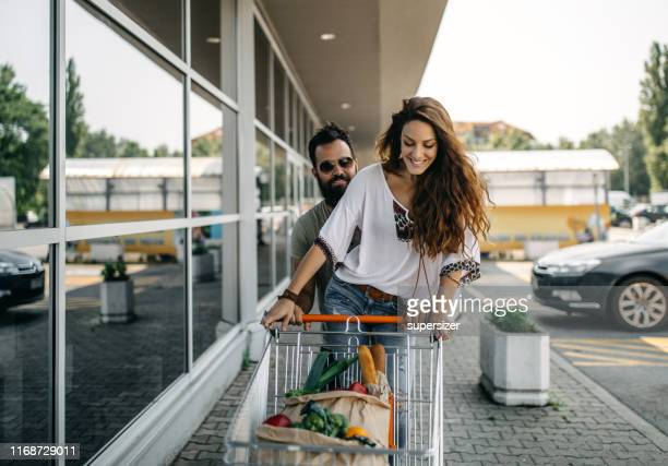young couple shopping for groceries - cart stock pictures, royalty-free photos & images