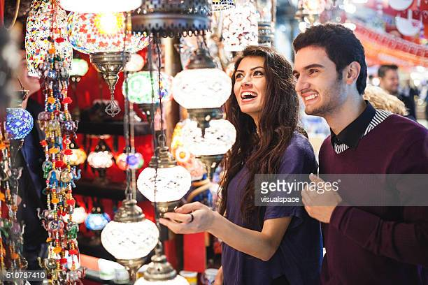 Young Couple Shopping in Bazaar