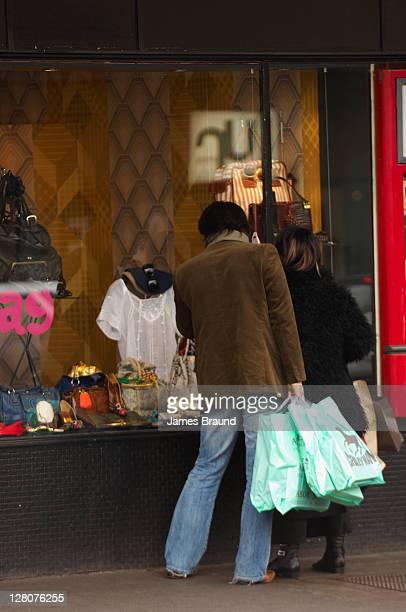 Young couple shopping in Brunswick Street, Fitzroy, Melbourne, Victoria, Australia