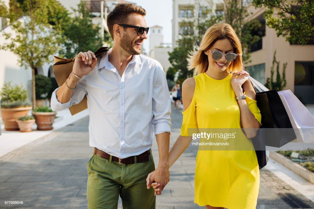 Young couple shopping in the city : Stock Photo
