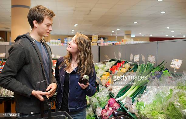 A young couple shopping in the fruit and vegetable section of a supermarket pictured on July 04 2013 in Bonn Germany