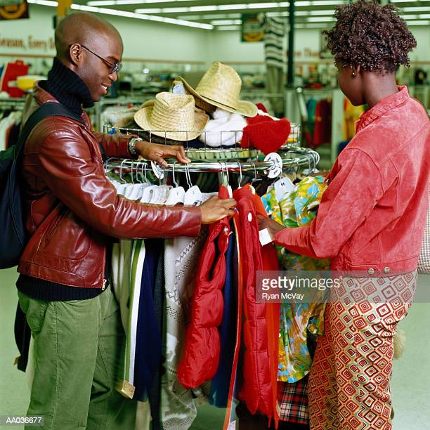 Young couple shopping in thrift store, side view