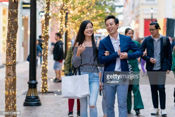 Young couple shopping together outdoors