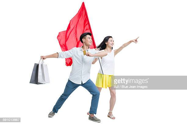 Young couple shopping with a red flag
