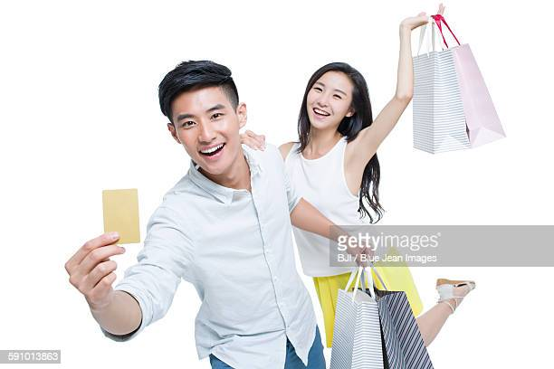 Young couple shopping with credit card