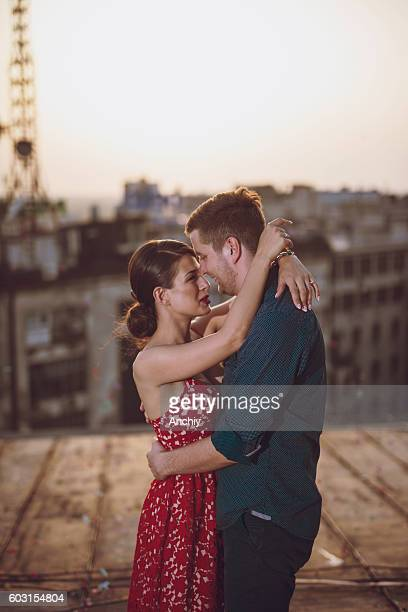 Young couple showing affection on the roof in paris