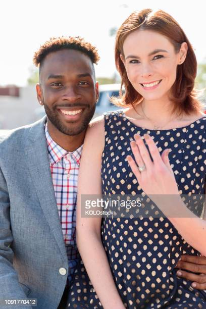 young couple showing off engagement ring - black women engagement rings stock pictures, royalty-free photos & images