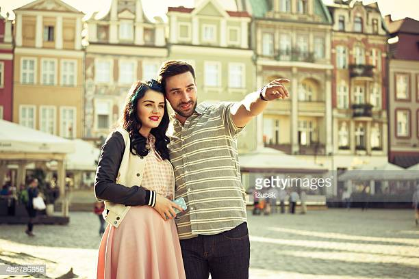 Young couple sightseeing european old town